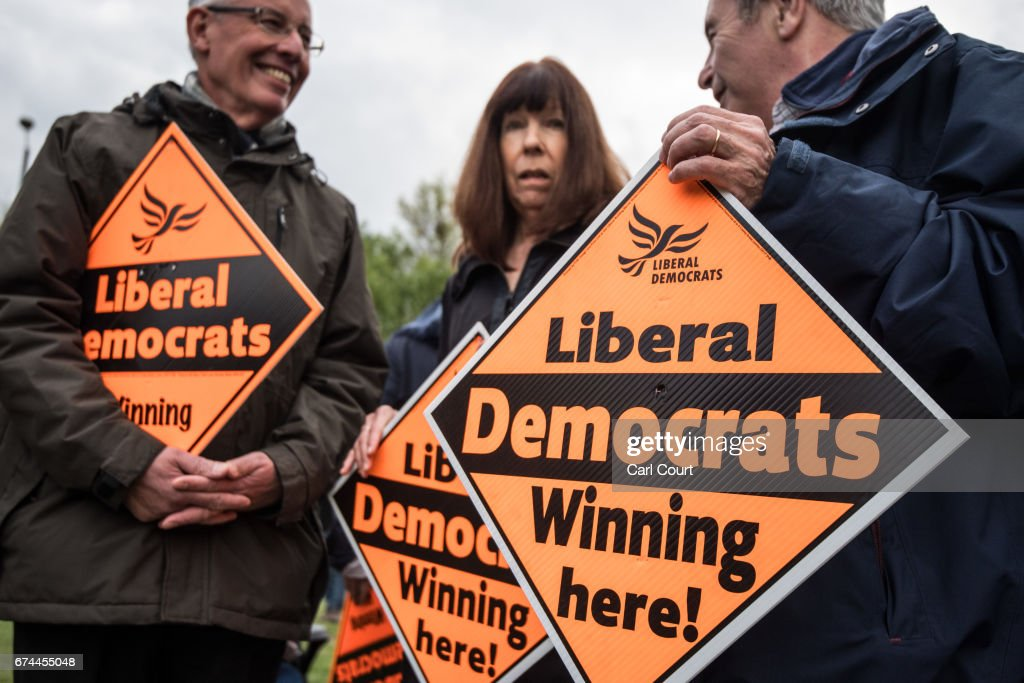 Supporters hold placards as former Liberal Democrat Secretary of State for Business, Innovation and Skills, Vince Cable, launches his campaign to return to parliament where he also warned of the risk of a second 'economic storm' caused by a hard Brexit, on April 28, 2017 in Twickenham, England.