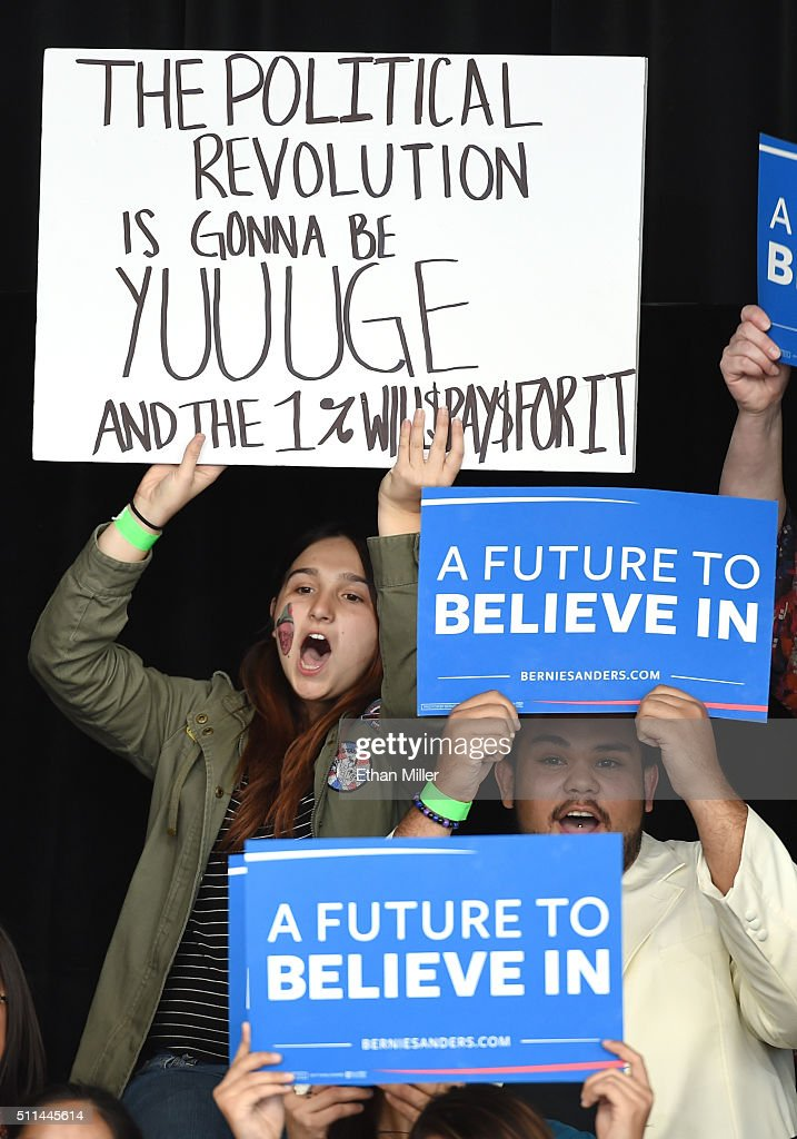 Supporters hold signs as Democratic presidential candidate Sen Bernie Sanders gives a concession speech at the Henderson Pavilion on February 20 2016...