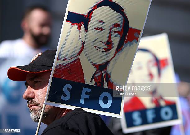 Supporters hold signs with the image of slain San Francisco supervisor Harvey Milk during a rally at San Francisco City Hall on February 22 2013 in...