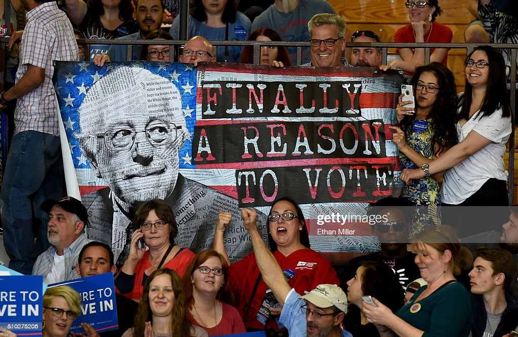 Supporters hold up a poster during a campaign rally by Democratic presidential candidate Sen. Bernie Sanders (I-VT) at Bonanza High School on February 14, 2016 in Las Vegas, Nevada. Sanders is challenging Hillary Clinton for the Democratic presidential nomination ahead of Nevada's Feb. 20 Democratic caucus.