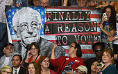 Supporters hold up a poster during a campaign rally by Democratic presidential candidate Sen Bernie Sanders at Bonanza High School on February 14...