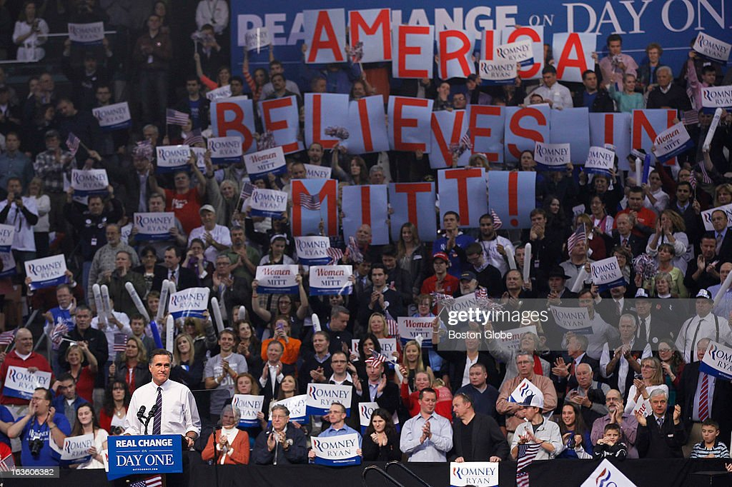 Supporters hold up letter signs that spell 'America Believes in Mitt!' GOP presidential candidate Mitt Romney holds a final victory rally at the Verizon Wireless Arena in Manchester, N.H. on Tuesday, Nov. 6, 2012. Musician Kid Rock performed for the rally.