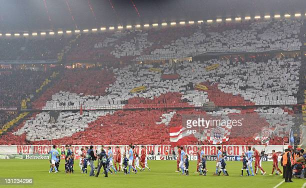 Supporters hold up posters to display the map of Europe during the Group A Champions League football match FC Bayern Munich vs SSC Napoli in the...