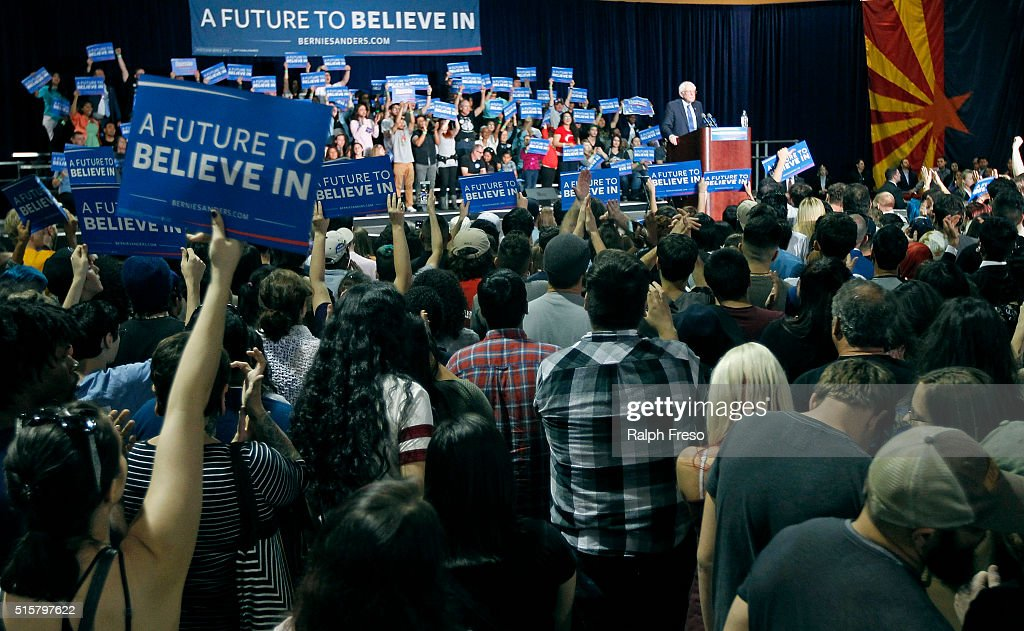 Supporters hold up signs as Democratic presidential candidate Sen. Bernie Sanders (D-VT) speaks at the Phoenix Convention Center during a campaign rally on March 15, 2016 in Phoenix, Arizona. Hillary Clinton won the Democratic primary elections in Florida, North Carolina and Ohio, while Missouri and Illinois remain tight races.(Photo by Ralph Freso/Getty Images))