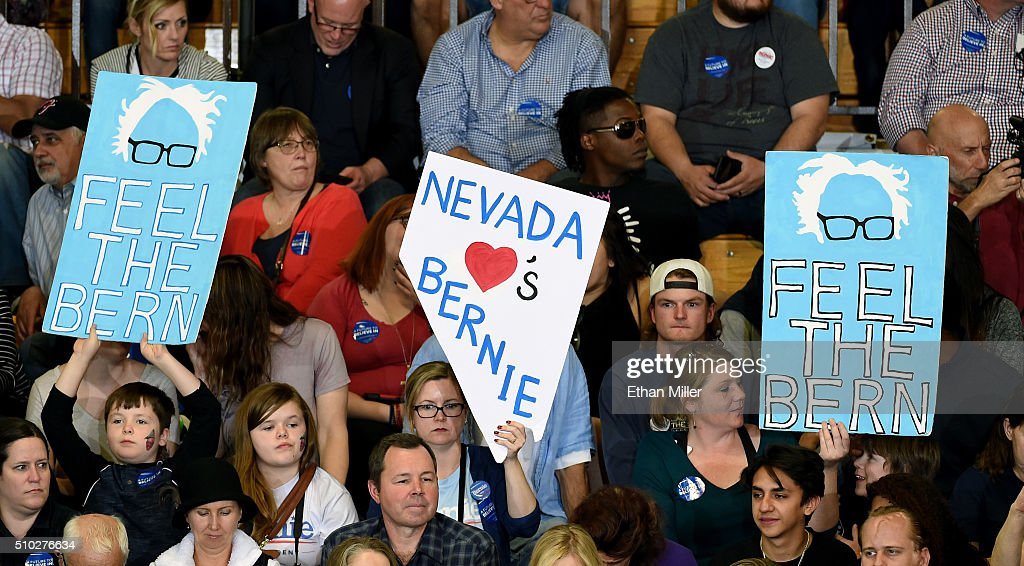 Supporters hold up signs before a campaign rally by Democratic presidential candidate Sen. Bernie Sanders (I-VT) at Bonanza High School on February 14, 2016 in Las Vegas, Nevada. Sanders is challenging Hillary Clinton for the Democratic presidential nomination ahead of Nevada's Feb. 20 Democratic caucus.