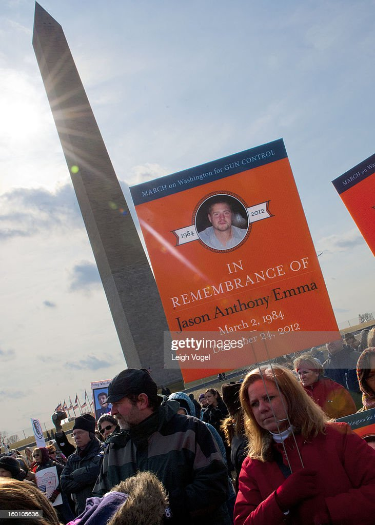 Supporters hold up signs during the Million Mom March for Gun Control near the Washington Monument on January 26, 2013 in Washington, DC.