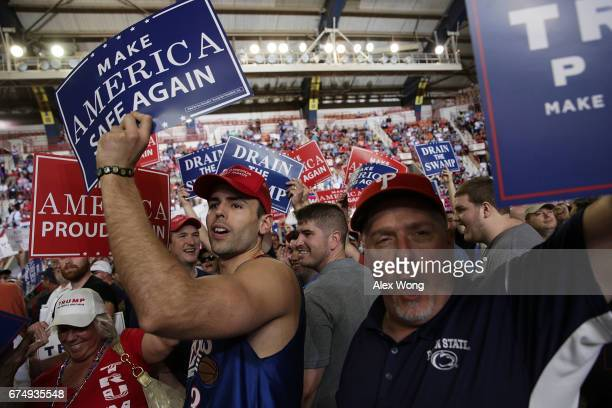 Supporters hold up signs prior to a 'Make America Great Again Rally' at the Pennsylvania Farm Show Complex Expo Center April 29 2017 in Harrisburg...