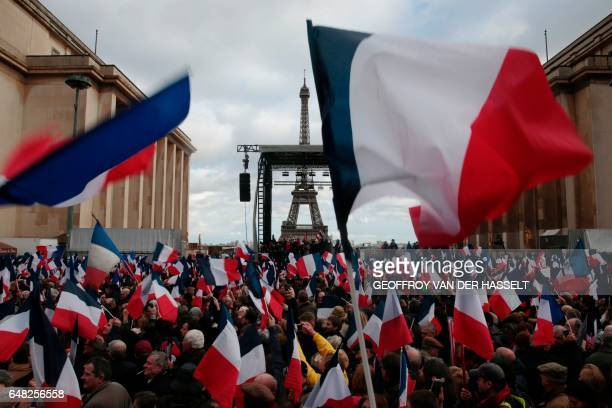 TOPSHOT Supporters holding French flags gather for a rally in support of French presidential election candidate for the rightwing Les Republicains...