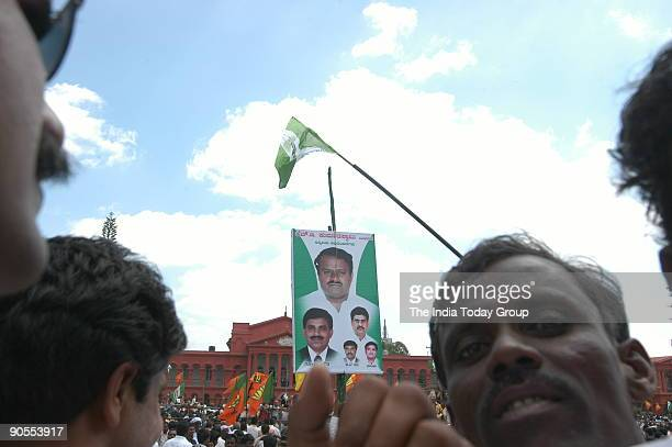 Supporters holding Kumaraswamy's posters outside the Vidhana Soudha The New BJPJD coalition Government swearingin ceremony at Vidhana Soudha in...