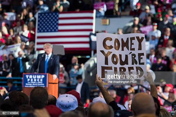 A supporters holds up a 'Comey You're Fired' sign as Republican presidential candidate Donald Trump speaks during a campaign event at JS Dorton Arena...