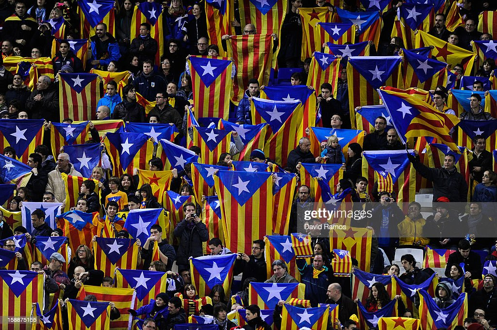 Supporters hols up Catalonian Pro-independence flags during a friendly match between Catalonia and Nigeria at Cornella-El Prat Stadium on January 2, 2013 in Barcelona, Spain.