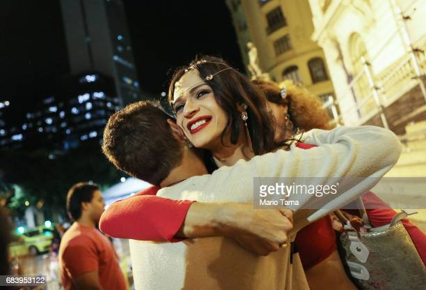 LGBT supporters hug outside a protest held inside city council on May 16 2017 in Rio de Janeiro Brazil Protestors occupied the chamber in a...