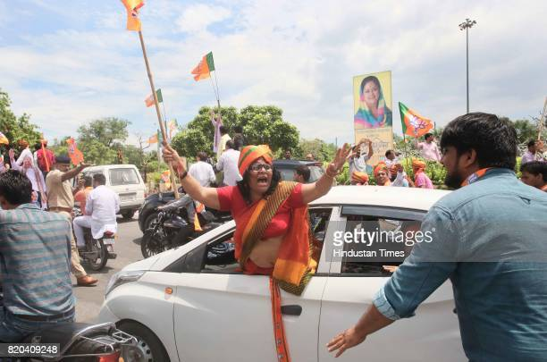 Supporters in a procession of BJP National President Amit Shah who was on his way from Sanganer Airport to party office on the first day of his...