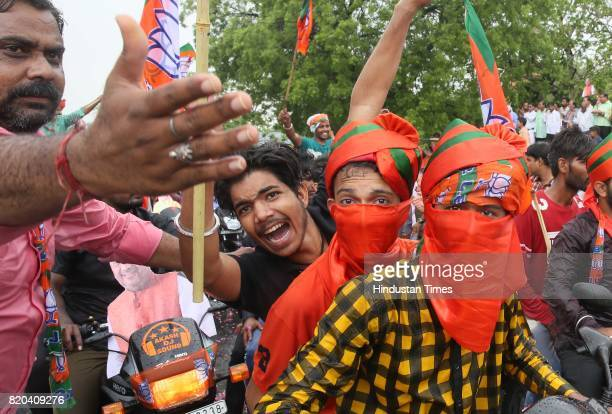 Supporters in a welcome procession during sudden showers while BJP National President Amit Shah was on his way in a procession from Sanganer Airport...