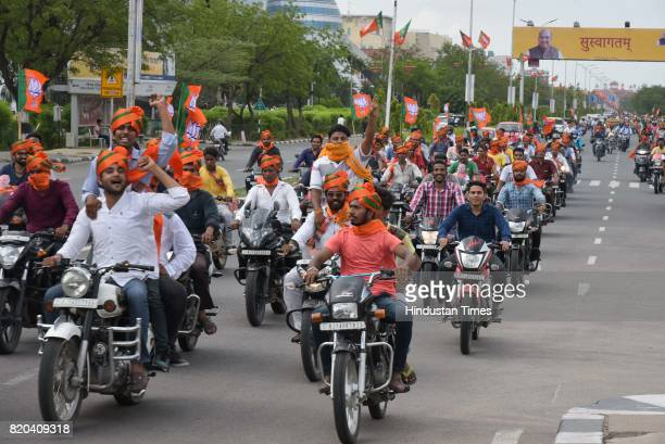 Supporters in a welcome procession of BJP National President Amit Shah on his way in a procession from Sanganer Airport to party office on the first...
