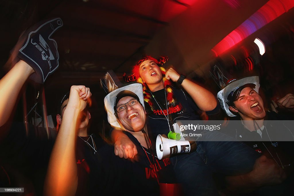 Supporters in his home town celebrate the third World Championship title of German Formula One driver Sebastian Vettel during a public viewing in Vettel's home town on November 25, 2012 in Heppenheim, Germany.