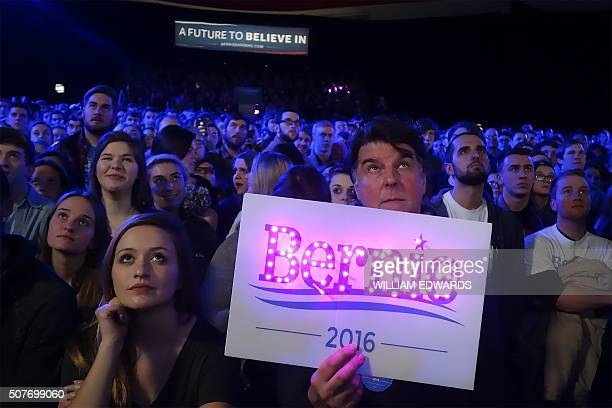 TOPSHOT Supporters listen as Democratic presidential candidate Bernie Sanders addresses a campaign event at the University of Iowa in Iowa City Iowa...
