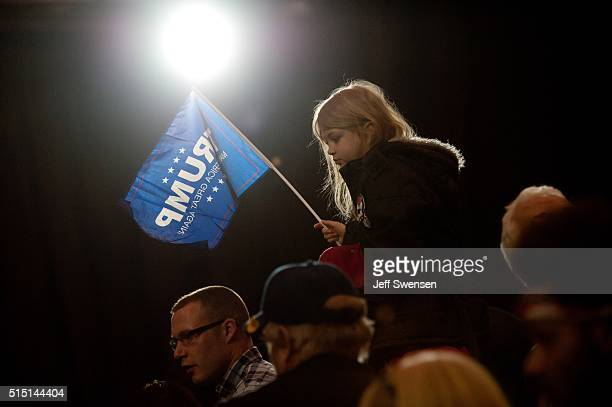 Supporters listen as Republican presidential candidate Donald Trump speaks at a campaign event at the IX Center March 12 2016 in Cleveland Ohio