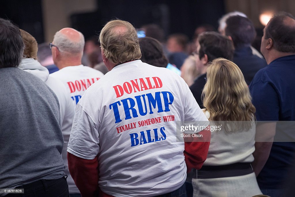 Supporters listen as Republican presidential candidate Donald Trump speaks at a campaign rally at the Radisson Paper Valley Hotel on March 30 2016 in...