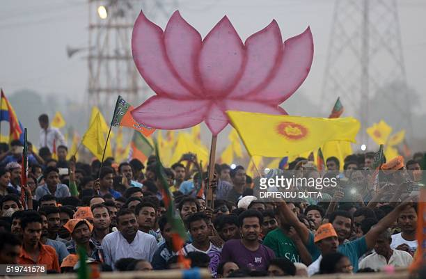 Supporters listen to a speech by Indian Prime Minister Narendra Modi at a campaign rally in Gosaipur on the outskirts of Siliguri on April 7 2016...