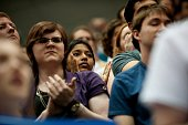 Supporters listen to Democratic presidential candidate Bernie Sanders speak at a rally at the Rec Hall at Penn State University on April 19 2016 in...