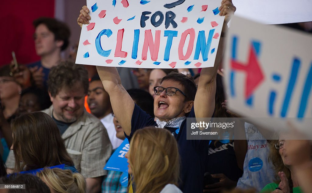 Supporters listen to Democratic presidential candidate Hillary Clinton speak at a rally at John Marshall High School August 17, 2016 in Cleveland, Ohio.