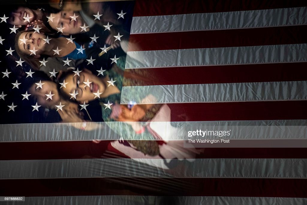 CLEVELAND OH Supporters listen to former Secretary of State Hillary Clinton as she speaks in a full gym at Cuyahoga Community College during an...