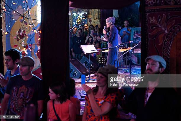 Supporters listen to Green party candidate Jill Stein reflected in a mirror as she speaks to a standing room only crowd at the Mercury Cafe on August...