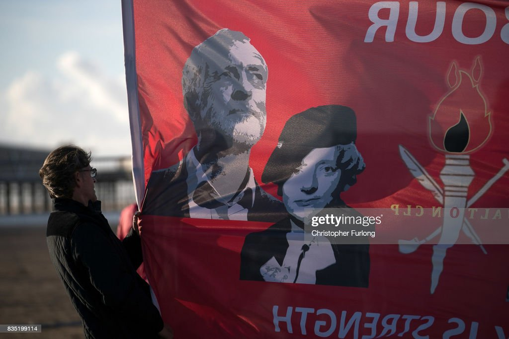Supporters listen to Labour Party Leader Jeremy Corbyn as he addresses a rally on Southport Beach on August 18, 2017 in Southport, England. Jeremy Corbyn is in the north west as part of his UK wide tour visiting marginal seats.