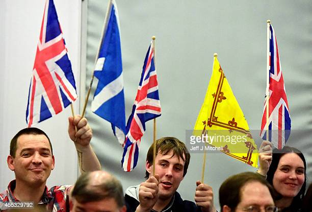 UKIP supporters listen to leader Nigel Farage as he addresses a rally on Scottish Independence on September 12 2014 in Glasgow Scotland Mr Farage...