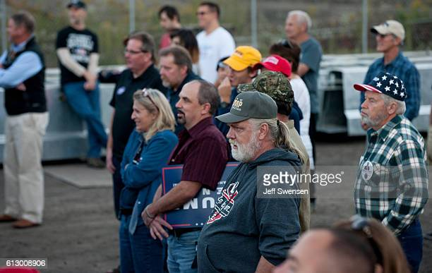 Supporters listen to Republican candidate for Vice President Mike Pence as he speaks to close to 250 supporters at a rally at JWF Industries in...