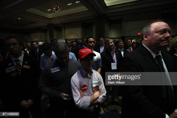 Supporters listen to Republican gubernatorial candidate Ed Gillespie speak at an election night rally on November 7 2017 in Richmond Virginia...