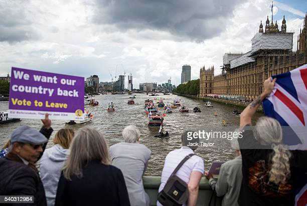 Supporters look on as boats from the 'Fishing for Leave' campaign group and boats from the 'In' campaign join a flotilla along the Thames River...