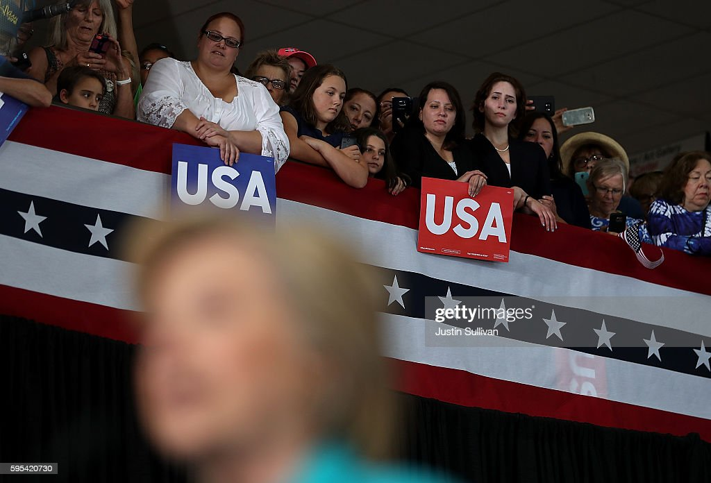 Supporters look on as democratic presidential nominee former Secretary of State Hillary Clinton speaks during a campaign even at Truckee Meadows...
