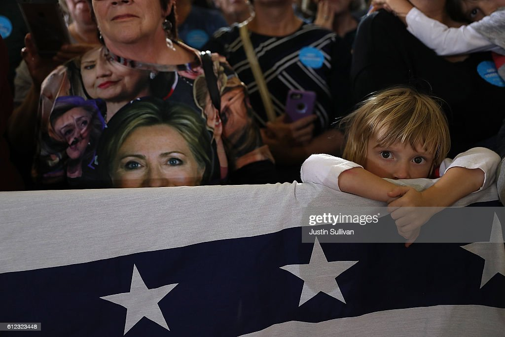 Supporters look on as democratic presidential nominee former Secreatry of State Hillary Clinton speaks during a campaign rally at Goodyear Hall and...