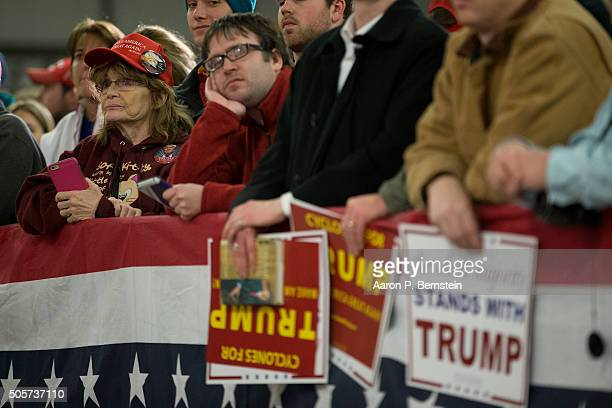 Supporters look on as Republican presidential candidate Donald Trump speaks at Hansen Agriculture Student Learning Center at Iowa State University on...