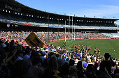 Supporters look on as the Eagles jog laps during a West Coast Eagles AFL training session at Domain Stadium on September 28 2015 in Perth Australia