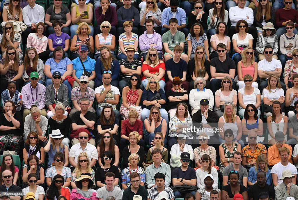 Supporters look on as Venus Williams of The United States faces Maria Sakkari of Greece in the Ladies Singles second round match on day four of the Wimbledon Lawn Tennis Championships at the All England Lawn Tennis and Croquet Club on June 30, 2016 in London, England.