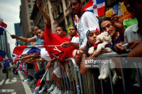 Supporters look on at the start of the annual Dominican Day parade August 9 2009 in New York City The annual parade draws hundreds of thousands of...