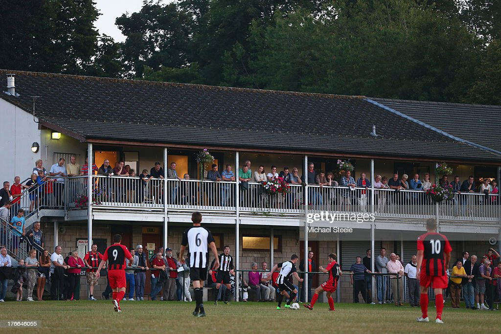 Supporters look on from the clubhouse during the FA Cup Extra Preliminary Round match between Alresford Town and Winchester City at Alrebury Park on August 16, 2013 in New Alresford, England.