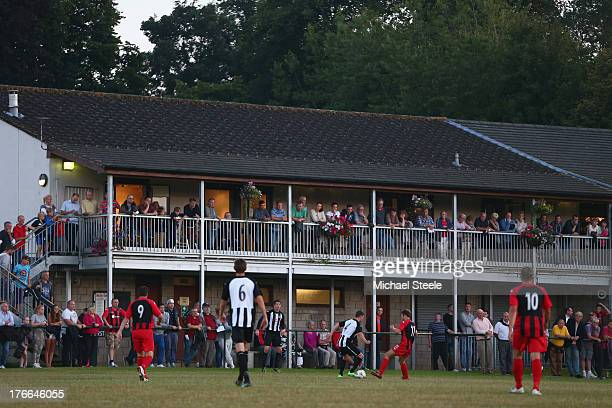 Supporters look on from the clubhouse during the FA Cup Extra Preliminary Round match between Alresford Town and Winchester City at Alrebury Park on...