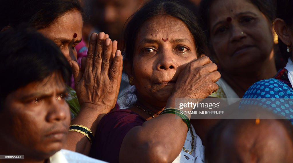 Supporters mourn during the funeral of Indian Hindu nationalist Shiv Sena party leader Bal Thackeray in Mumbai on November 18, 2012. Huge crowds gathered in Mumbai to witness the funeral procession of Bal Thackeray, chief of the Hindu nationalist Shiv Sena party and one of India's most divisive politicians. Thackeray, who called his followers 'Hindu warriors' and was widely accused of stoking ethnic and religious violence, died aged 86, triggering a virtual shutdown of the city. AFP PHOTO/INDRANIL MUKHERJEE