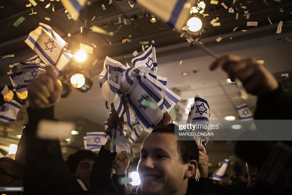 Supporters Naftali Bennett, head of the Israeli hard-line national religious party, Jewish Home, celebrate after exit polls were announced on January 22, 2013 at the party headquarters in Tel Aviv . Israeli Prime Minister Benjamin Netanyahu's Likud-Beitenu list was the top vote getter in today's election but the rightwing combination was weakened by a strong showing by the centrist Yesh Atid, according to TV exit polls.