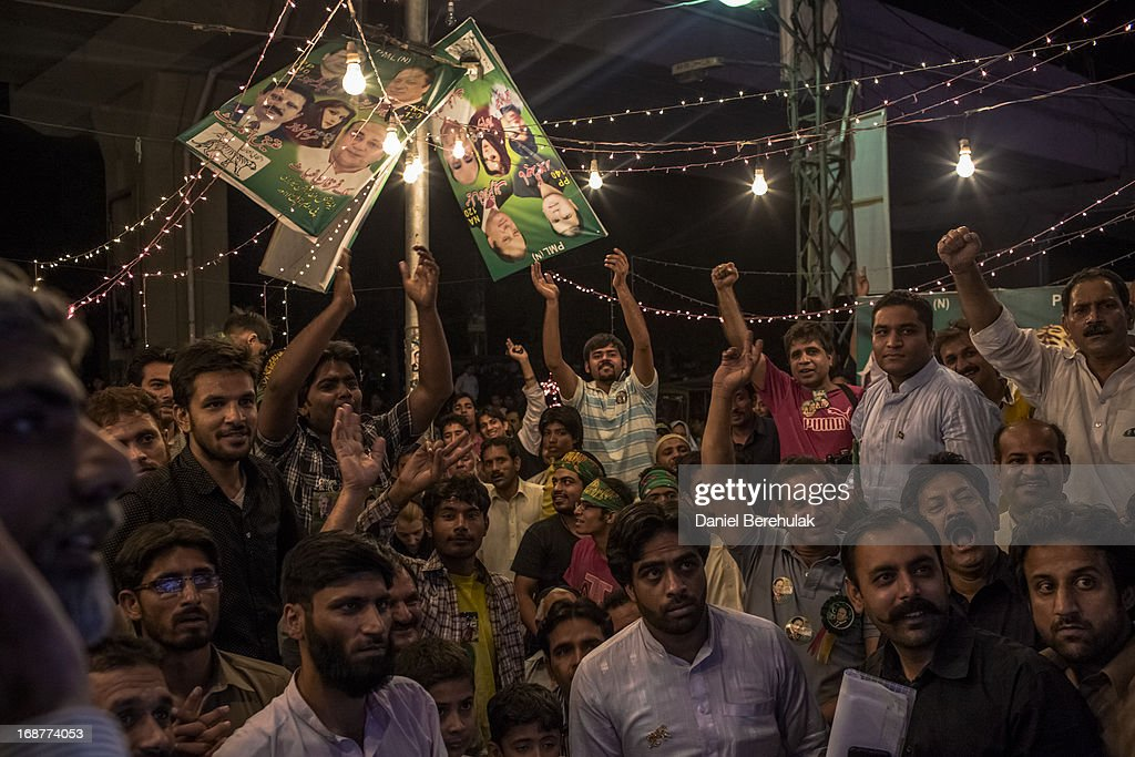 Supporters Nawaz Sharif of Pakistan Muslim League-N (PMLN) watch intently as election results are announced on a television in front of a party office late evening on May 11, 2013 in Lahore, Pakistan. Millions of Pakistanis cast their votes in parliamentary elections held today on May 11. It is the first time in the country's history that an elected government will hand over power to another elected government.