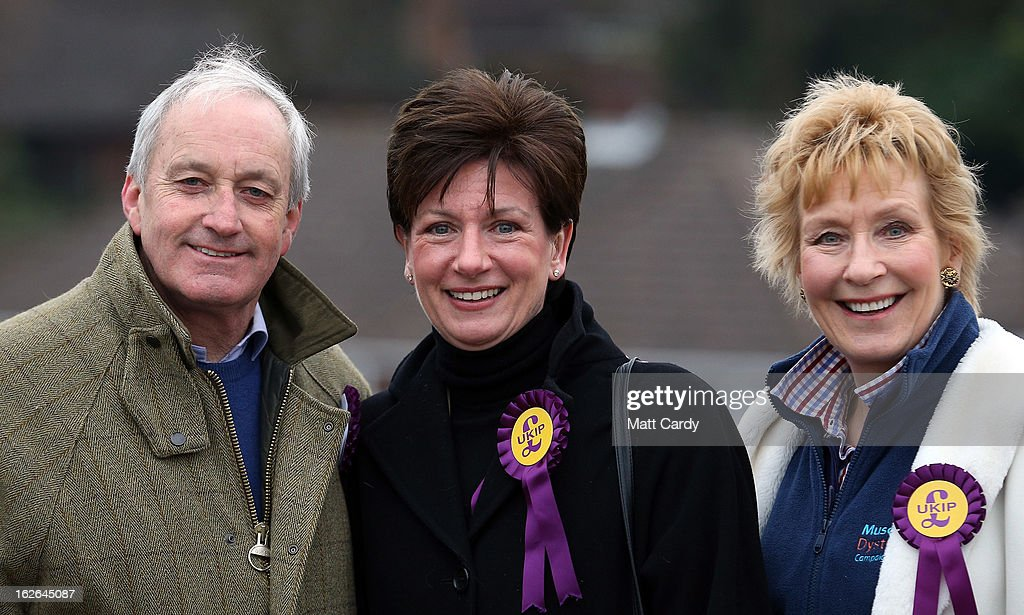 UKIP supporters Neil and <a gi-track='captionPersonalityLinkClicked' href=/galleries/search?phrase=Christine+Hamilton&family=editorial&specificpeople=208153 ng-click='$event.stopPropagation()'>Christine Hamilton</a> join local candidate Diane James (C) as they help campaign for UKIP in the forthcoming by-election on February 25, 2013 in Eastleigh, England. The by-election is being fought for the former seat of ex-Liberal Democrat MP Chris Huhne and will be held on February 28, 2013.