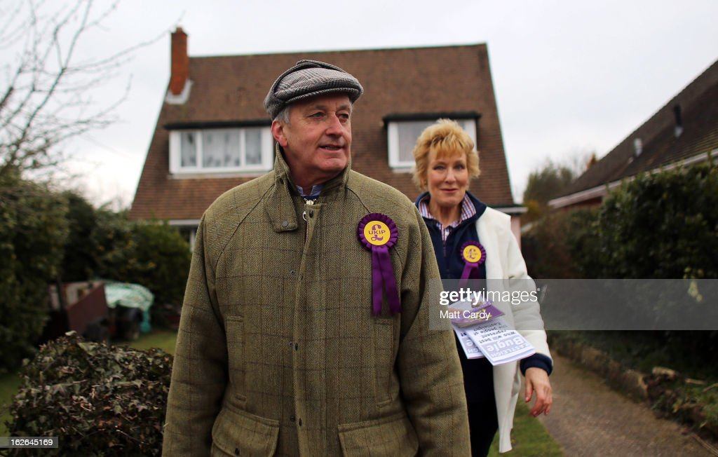 UKIP supporters Neil and <a gi-track='captionPersonalityLinkClicked' href=/galleries/search?phrase=Christine+Hamilton&family=editorial&specificpeople=208153 ng-click='$event.stopPropagation()'>Christine Hamilton</a> knock on doors in a street as they help UKIP campaign for the forthcoming by-election on February 25, 2013 in Eastleigh, England. The by-election is being fought for the former seat of ex-Liberal Democrat MP Chris Huhne and will be held on February 28, 2013.