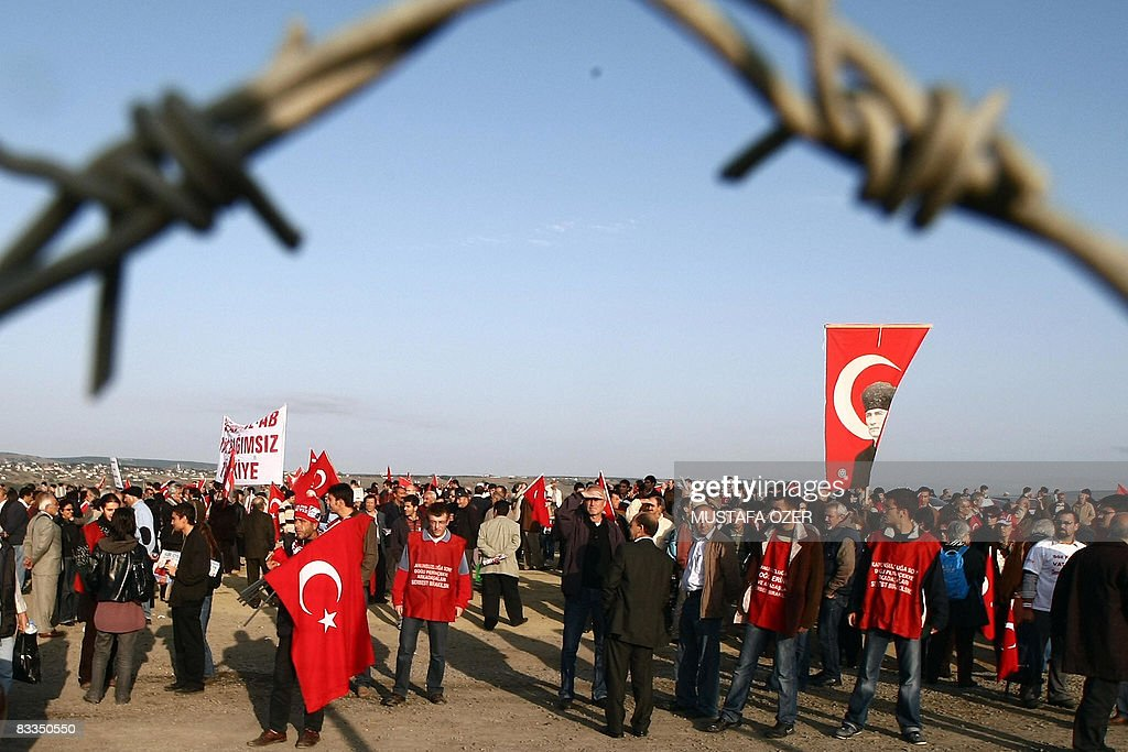 Supporters of a shadowy armed group Ergenekon that plotted to overthrow the country's Islamistrooted government chant slogans and wave Turkish on...