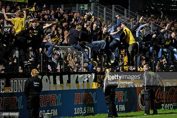 Supporters of Aachen celebrate their team after winning the Regionalliga West match against Viktoria Koeln at Sportpark Hoehenberg on October 31 2014...