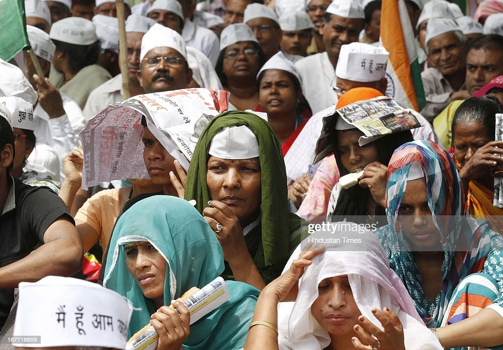 Supporters of Aam Admi Party leader Arvind Kejriwal, during a protest against the Delhi government demanding reduction in water and power tariffs at Jantar Mantar on April 28, 2013 in New Delhi, India. The Arvind Kejriwal-led party decided to call off their march to residence of Delhi Chief Minister Sheila Dikshit after her office accepted to receive the 10.5 lakh letters written against inflated power and water bills.