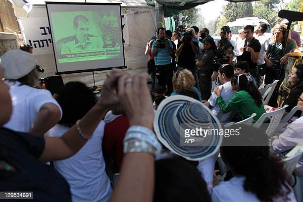 Supporters of abducted Israeli soldier Gilad Shalit celebrate his release on October 18 2011 at his family's protest tent outside the prime minister...